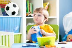 Kid playing with puzzle toy indoor Stock Photo