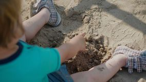 Kid Playing With Sand. Blonde Boy Playing With Sand stock video