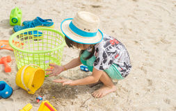 Kid is playing with sand box Stock Photography