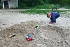 Kid playing in the sand Stock Photo