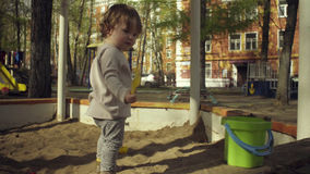 A kid playing in a sandbox Royalty Free Stock Photo