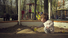 A kid playing in a sandbox Royalty Free Stock Photos