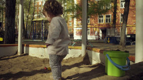 A kid playing in a sandbox Stock Photography