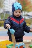Kid playing in sandbox Royalty Free Stock Photography