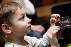 Kid playing shooting game Stock Photo