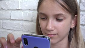 Kid Playing Smartphone Browsing Internet, Child, Girl Writing Messages on Device