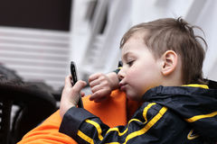 Kid playing with smartphone Royalty Free Stock Image