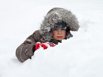 Kid playing in snow Royalty Free Stock Photography
