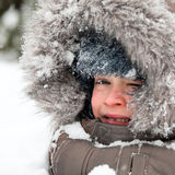Kid playing in snow Stock Photos