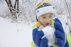 Kid playing with snow Stock Image