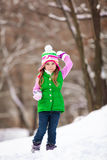 Kid playing snowballs Royalty Free Stock Image