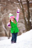 kid playing snowballs at winter park. Stock Image