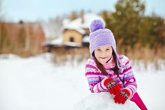 Kid playing with snowman Royalty Free Stock Images