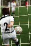 Kid playing soccer Royalty Free Stock Image
