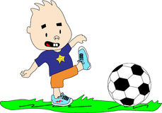 Kid Playing With Soccer Ball. Kid plays with soccer ball on the grass Stock Photos