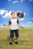 Kid playing soccer outside stock images