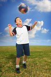 Kid playing soccer outside royalty free stock photo