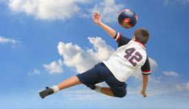 Kid playing soccer outside royalty free stock photography