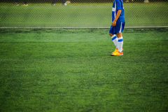 Kid playing soccer Royalty Free Stock Images