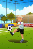 Kid Playing Soccer. A vector illustration of a boy soccer player kicking a ball Royalty Free Stock Photo