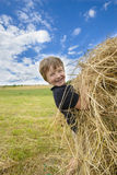 Kid Playing with Straw Royalty Free Stock Photography