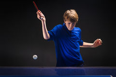 Kid playing table tennis Stock Photos