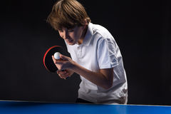 Kid playing table tennis Stock Image