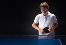Kid playing table tennis Royalty Free Stock Image