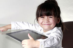 Kid playing Tablet royalty free stock photo