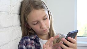 Kid playing tablet, child smartphone, teenager girl reading messages browsing internet