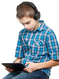 Kid playing with a tablet computer Royalty Free Stock Images