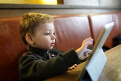 Kid playing on a Tablet PC Stock Photography