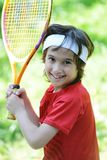 Kid playing tennis. In nature Royalty Free Stock Image