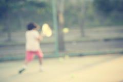 kid playing tennis Stock Image
