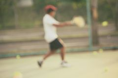 kid playing tennis Stock Photography