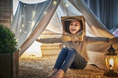 Kid playing in tent Stock Photography