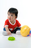 Kid playing toy Stock Photos