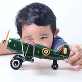 Kid playing with toy aircraft Royalty Free Stock Photo