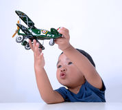 Kid playing with toy aircraft Stock Photography