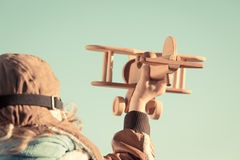 Kid playing with toy airplane Royalty Free Stock Photography