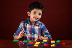 A kid playing with toy alphabets Royalty Free Stock Photos