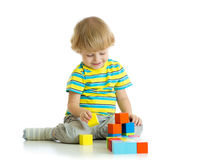 Kid playing toy blocks Royalty Free Stock Images
