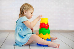 Kid playing toy blocks royalty free stock photography