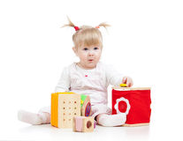 Kid playing toy blocks. Kid girl playing toy blocks on white background stock photos