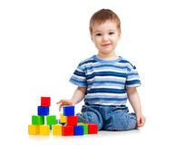 Kid playing toy blocks and looking to camera Stock Image