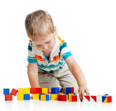 Kid playing toy blocks on white background Royalty Free Stock Photo