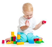 Kid playing toy blocks on white background Stock Photography