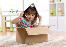 Kid playing in a toy house in children room Royalty Free Stock Images
