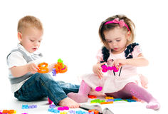 Kid playing toys royalty free stock images