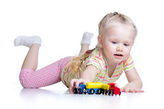 Kid playing toys isolated n white background Royalty Free Stock Images